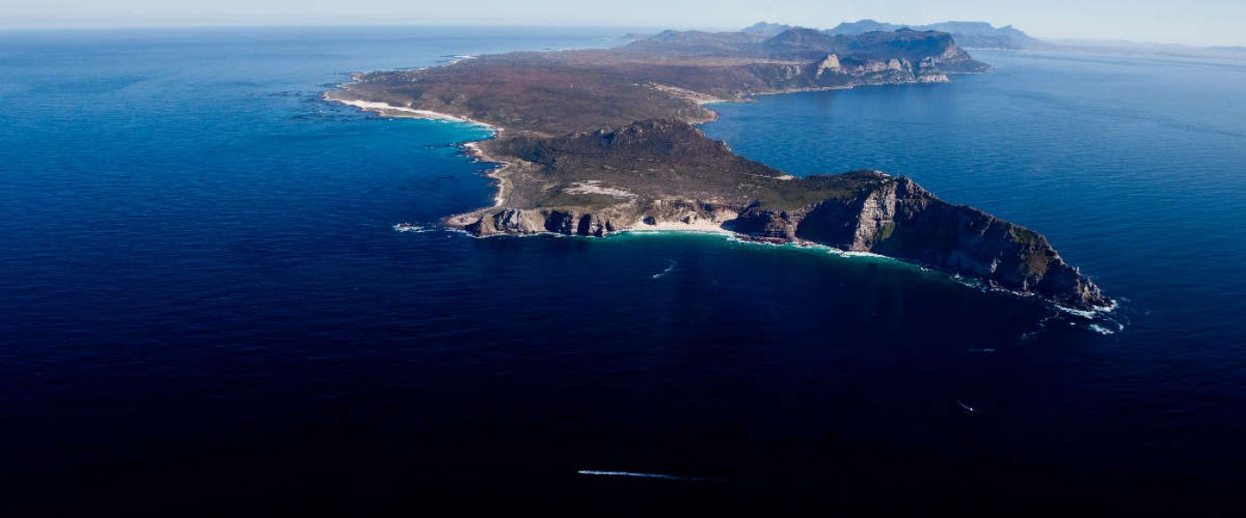 Cape Point Reserve stretching into a blue ocean surrounding it