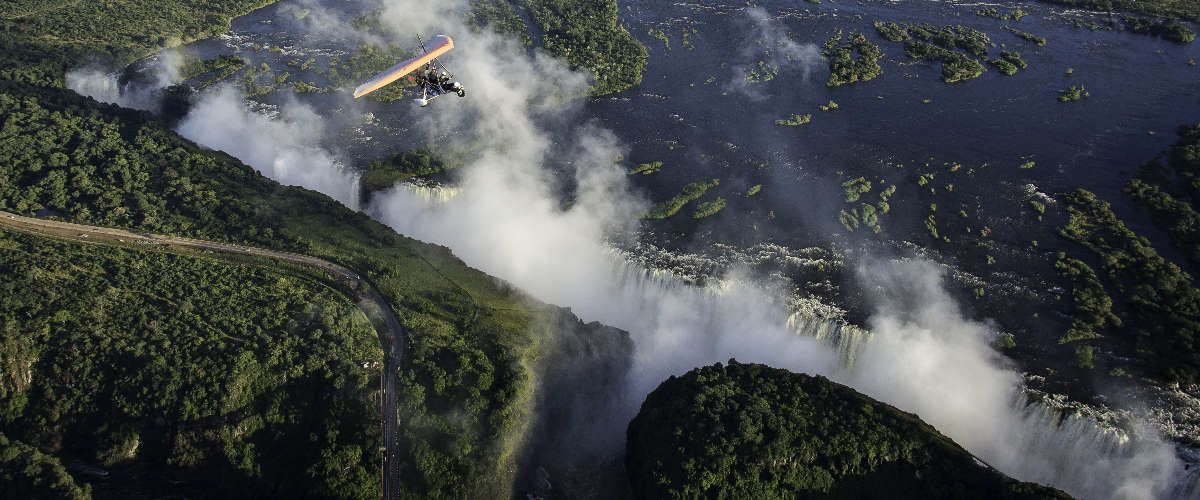 scenic microlight trip over a misty, 'smoke that thunders' Victoria Falls